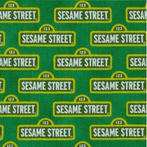 Picture of Sesame Street Signs in Rows on Green Cotton Fabric