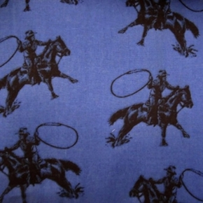Picture of Rodeo Roper Cowboys and Lassos on Blue Cotton Fabric