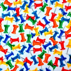 Office Push Pins Thumb Tacks on White Cotton Fabric