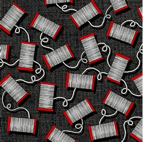 Picture of And Sew On Red Spools of White Thread on Black Cotton Fabric