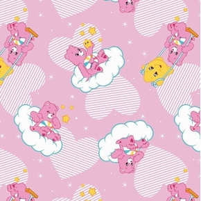 The Care Bears Hopeful Heart Bear Swinging Clouds Pink Cotton Fabric