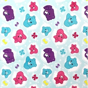 The Care Bears Sparkle and Shine Bows and Bubbles Blue Cotton Fabric